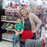 Farmington Elementary Teacher Kelly Baker helping out a elementary shopper.